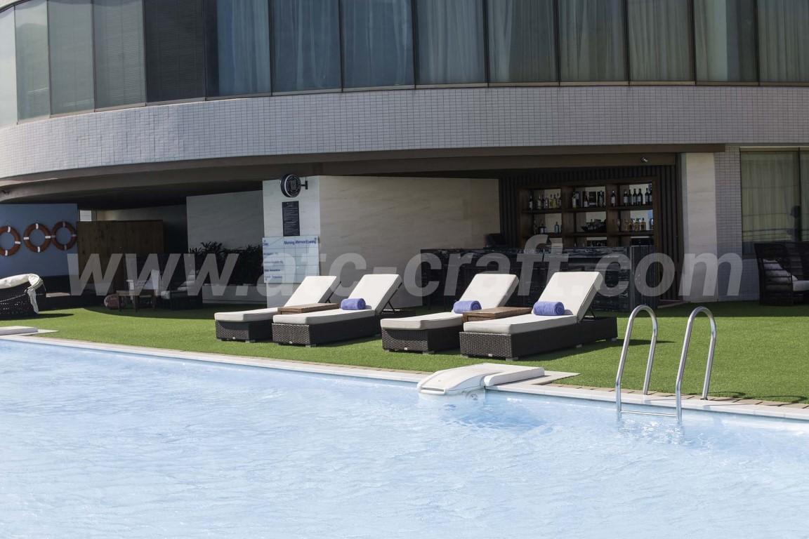 Coastal resort with poly wicker sunbeds