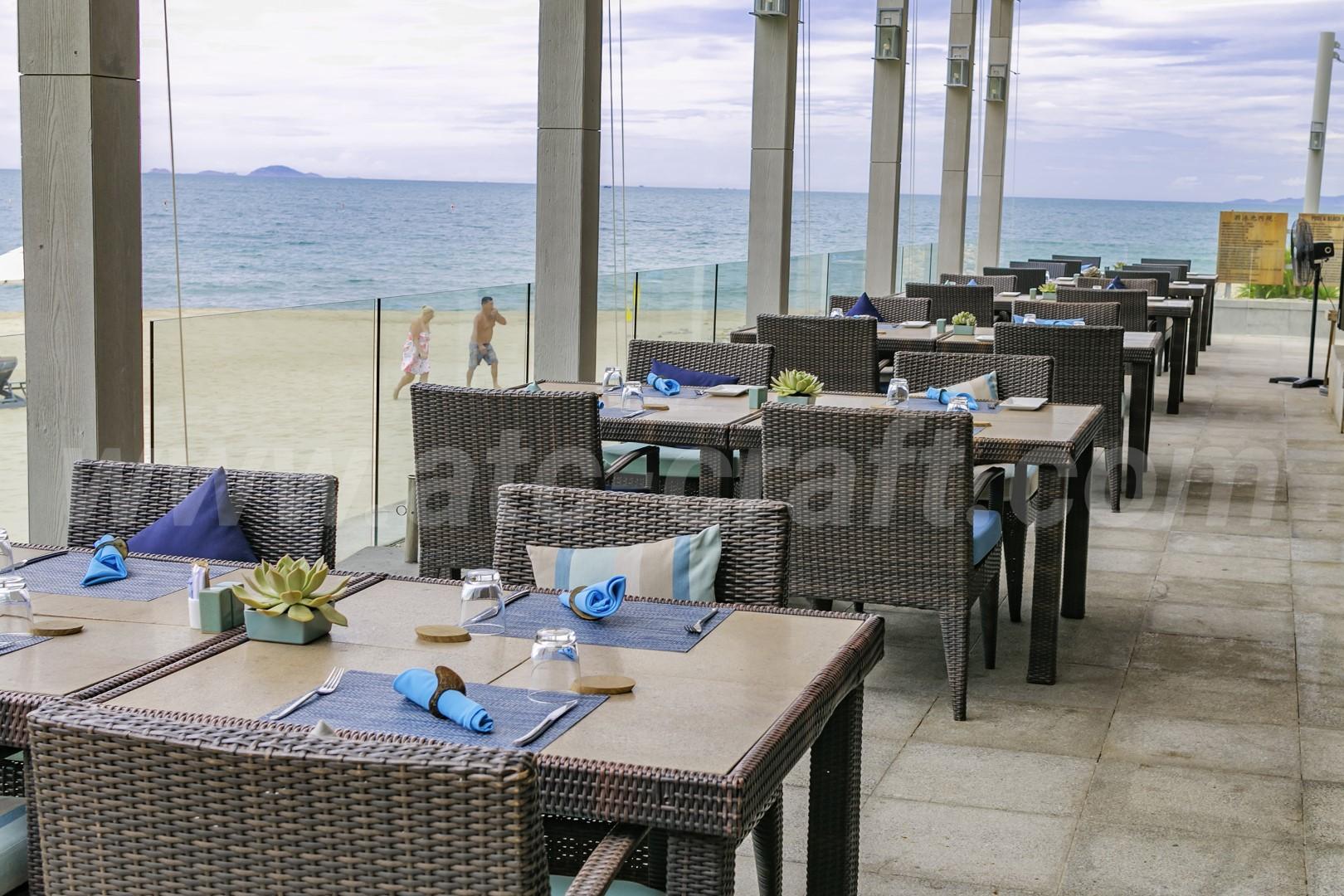blue marine resort with coastal patio dining set